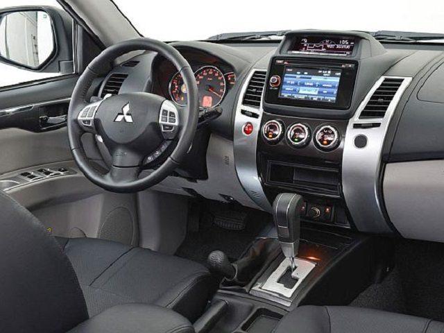 Mitsubishi pajero sport emg universal auto emg for Mitsubishi montero interior